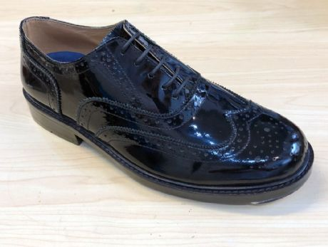 Exclusive black shiney patent leather brogues shoes ideal for use by military and civilian bands and for ceremonial and special occasion wear.